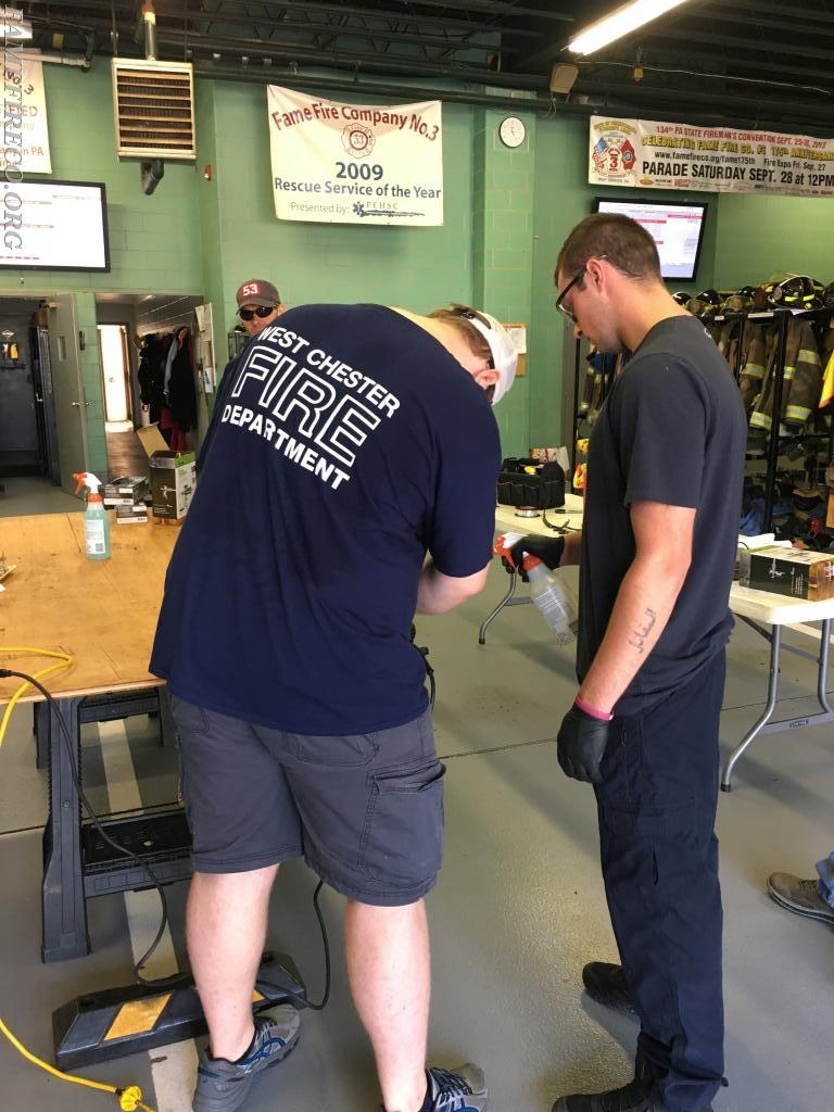 FF Jeremy Sullivan and FF Eric Duerr work together to disassemble the meat grinder!