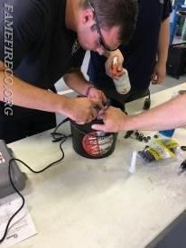 FF Eric Duerr concentrates on proper technique using the Dremel Tool to remove a ring off of a fellow FF.