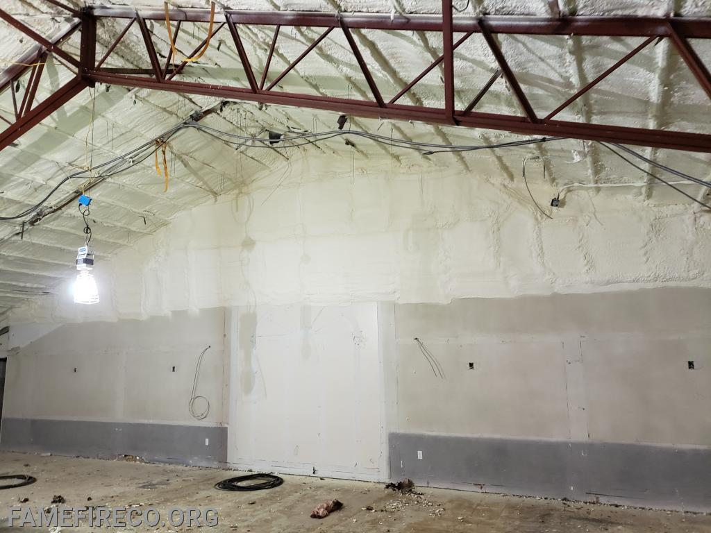 Spray insulation in the former Silsby Room.