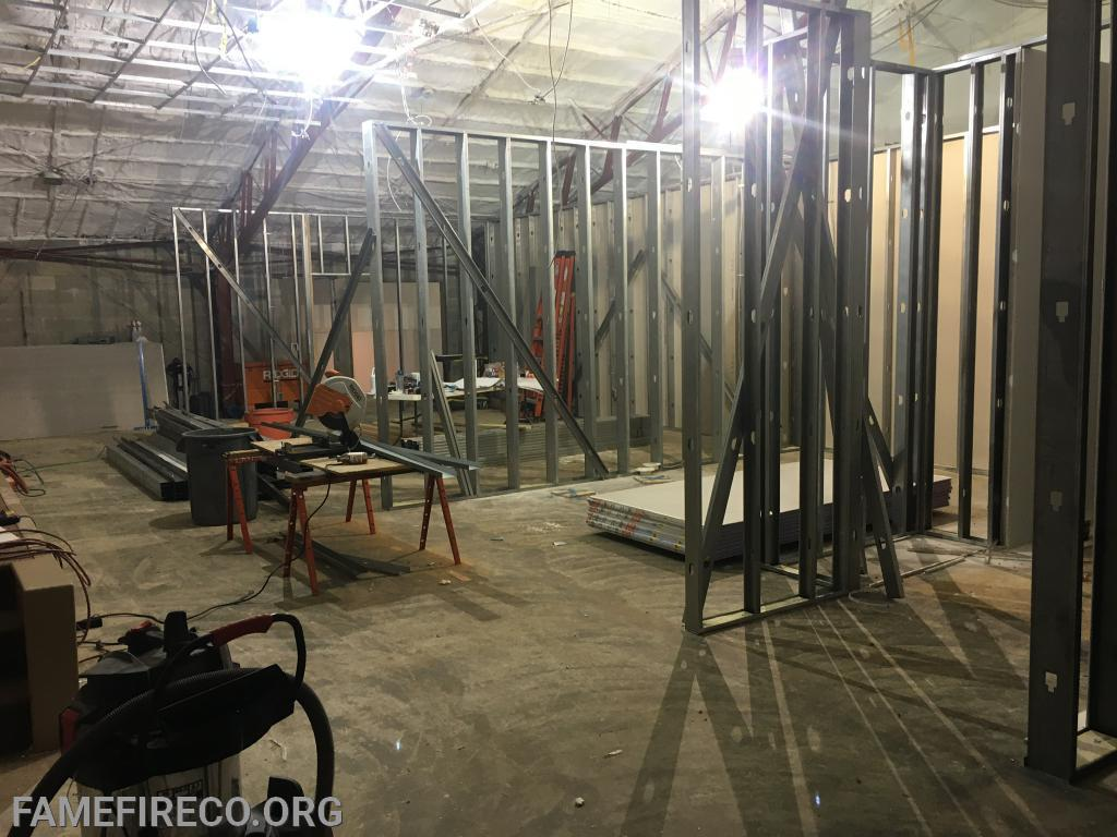 Framing going up for restrooms and office space in former Silsby Room.