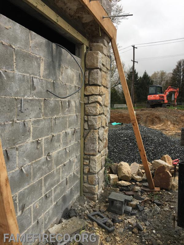 Stone work in progress around new front public entrance.