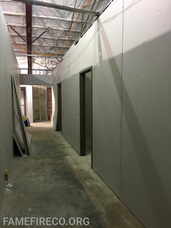 Door frames installed and additional dry wall installation in second floor bunk room area.