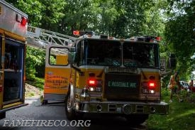 Ladder 53 positioned near front of fire building.  Photo by: IrishEyez Photography